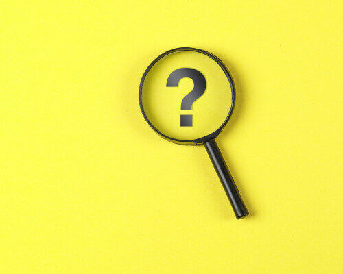 business-financial-concept-with-magnifying-glass-question-mark-yellow-background-flat-lay_176474-6555-626x400